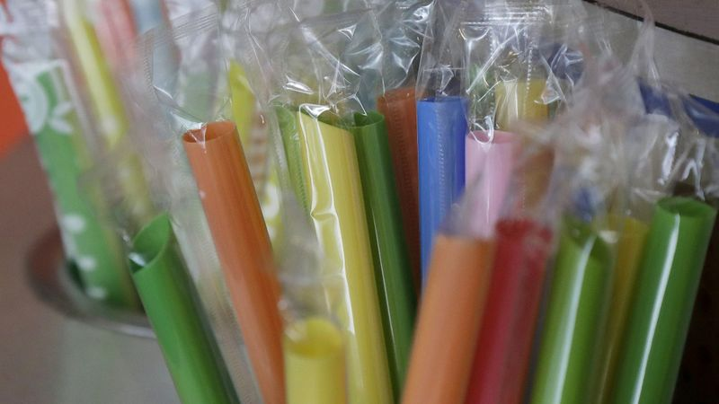 Plastic straws sit at the ready at a cafe in San Francisco. The state is considering barring dine-in restaurants from providing plastic straws unless they are requested by patrons. (Jeff Chiu / Associated Press)